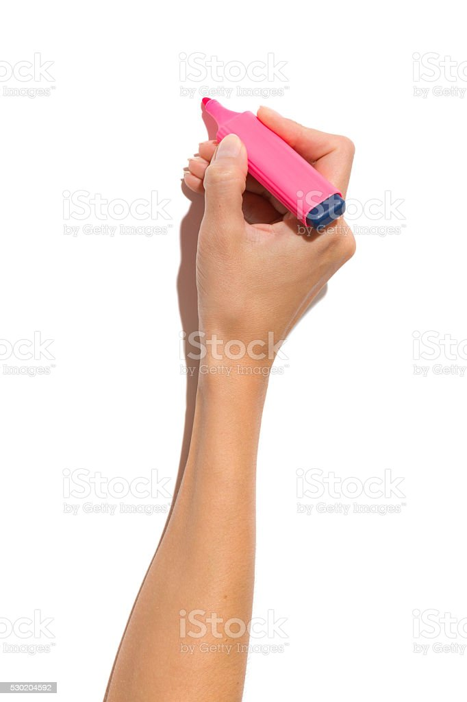 Writing Hand With Pink Highlighter stock photo
