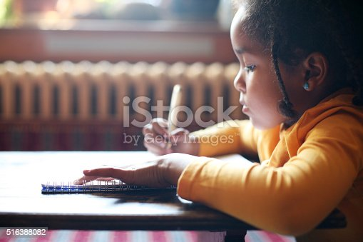 istock Writing her first book. 516388082