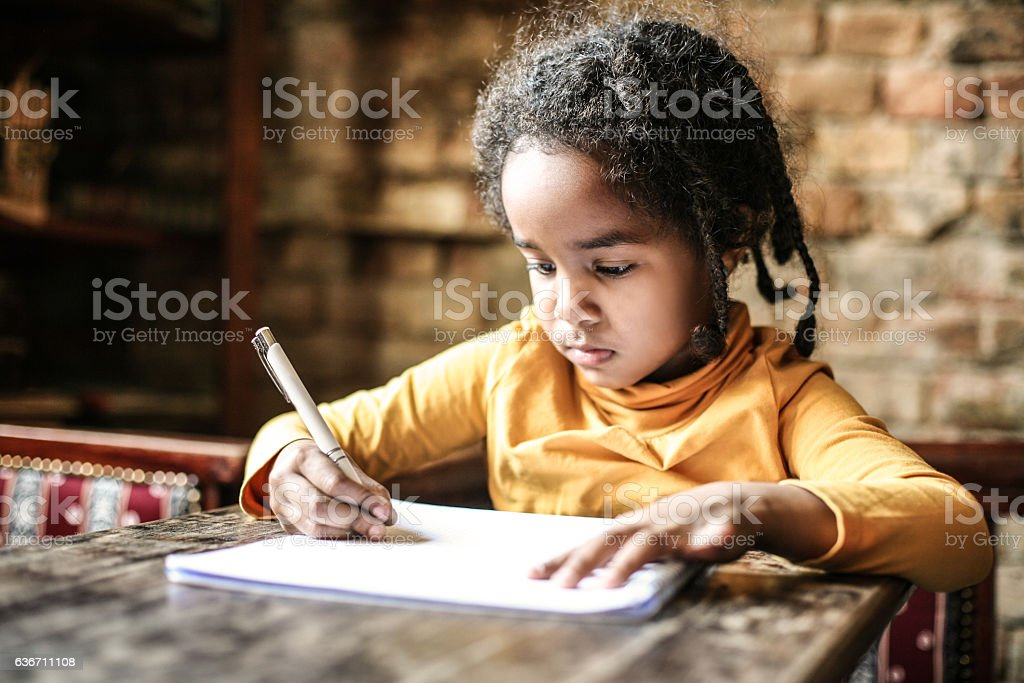 Writing her first book. stock photo