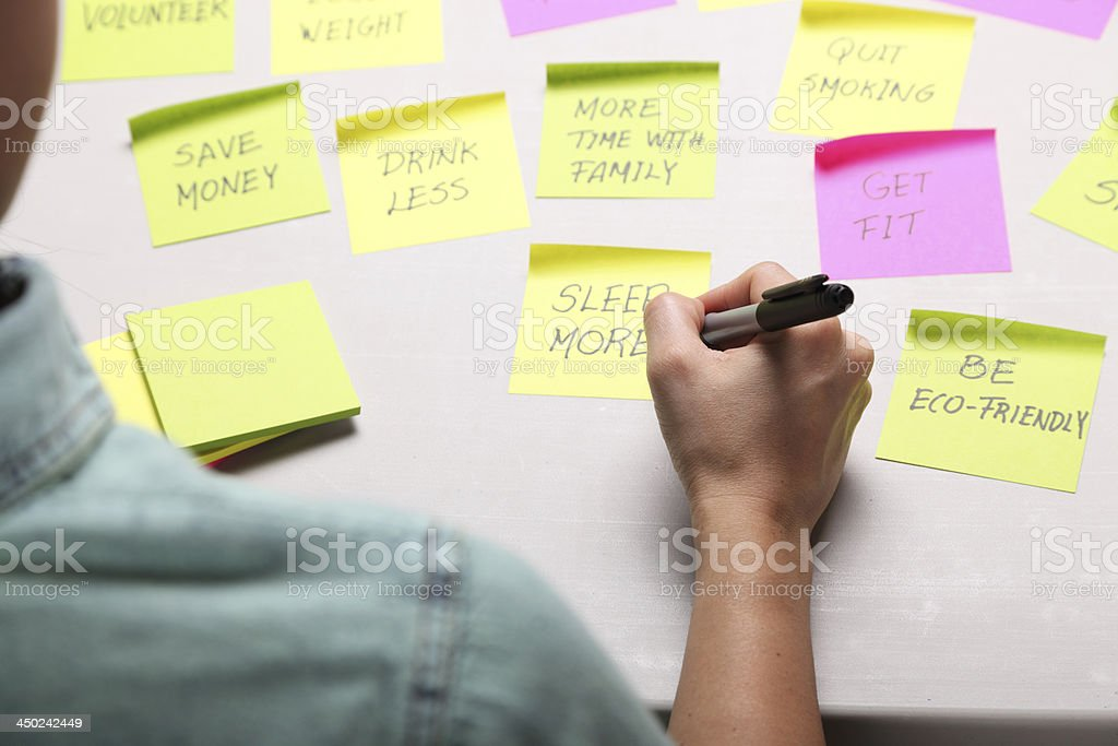 Writing her New Year's Resolutions stock photo