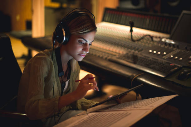 Writing her next song stock photo