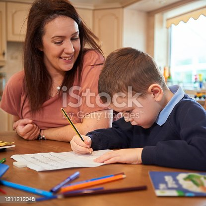 858130938 istock photo Writing homework 1211212048