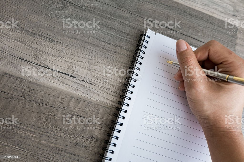 Writing in a blank note stock photo