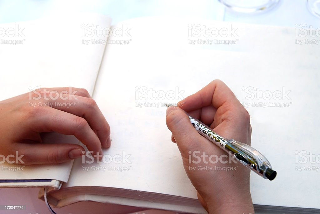 writing in a empty book stock photo