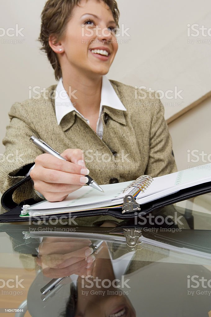 Writing in a planner. royalty-free stock photo