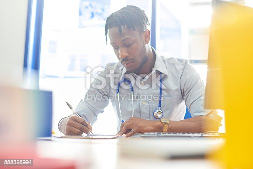 istock Writing in medical records 888368994