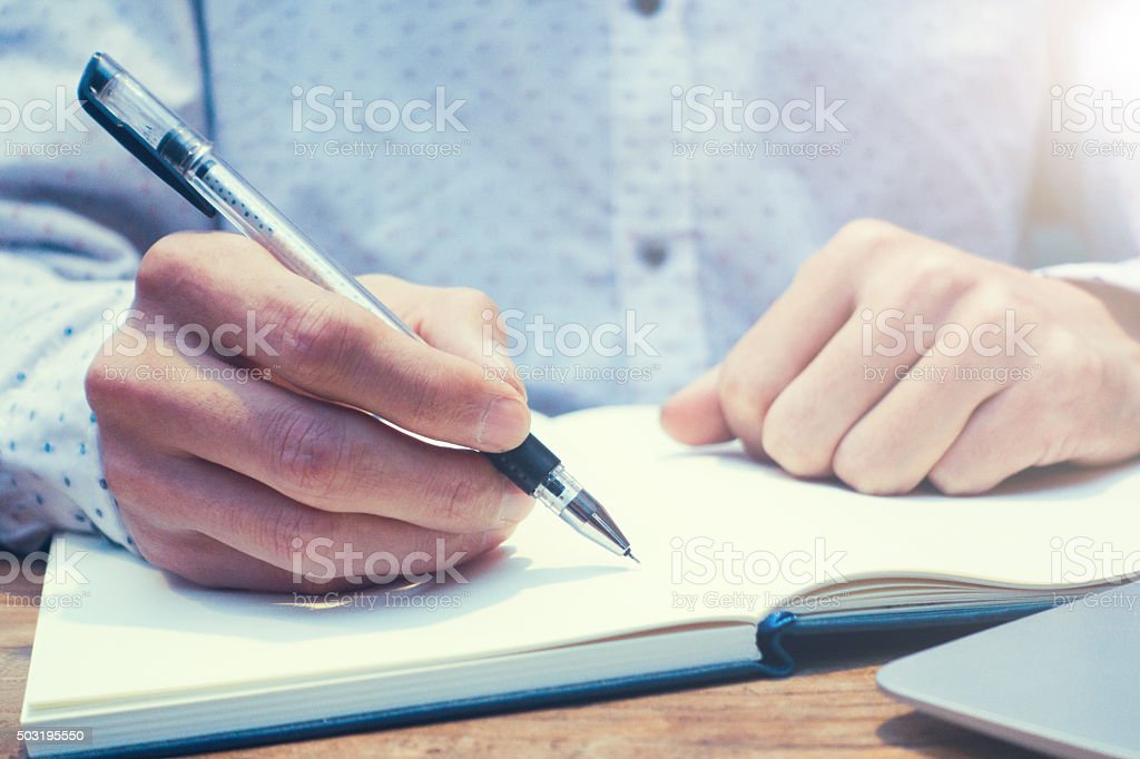 writing in notebook stock photo