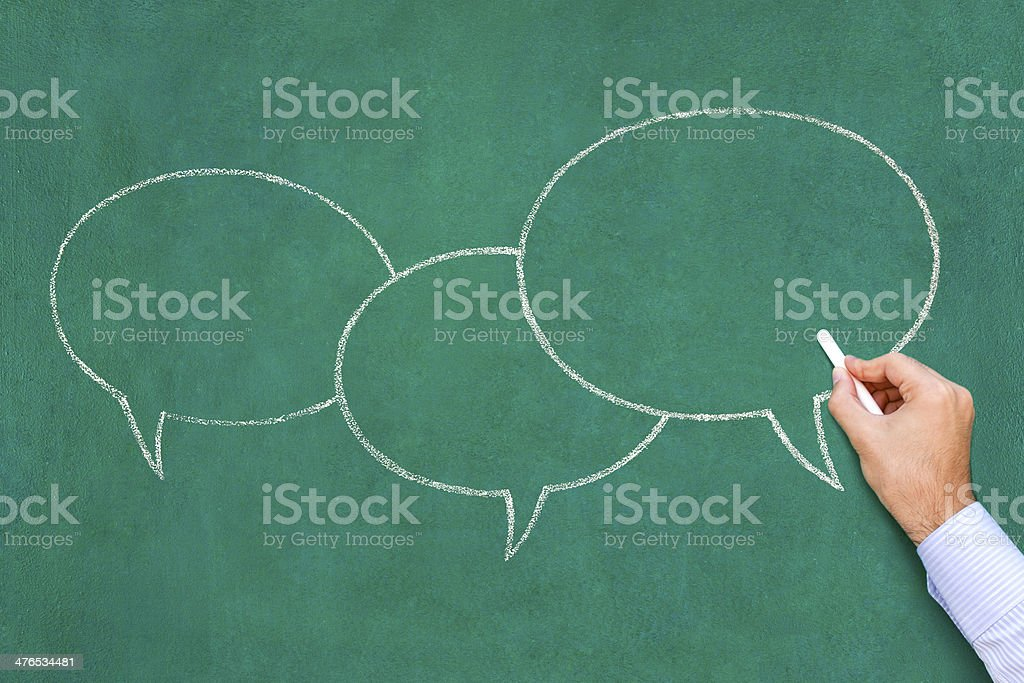 Writing in speech bubble on blackboard royalty-free stock photo