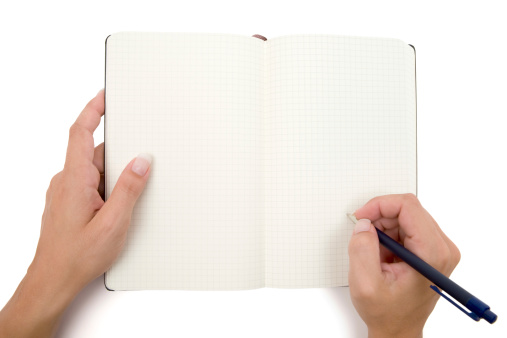 Female hands holding pen and notebook. Ready to write something down. White background.