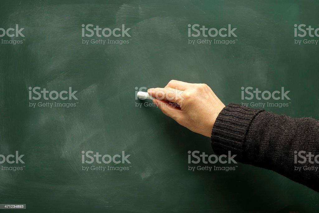 Writing it on the blackboard royalty-free stock photo