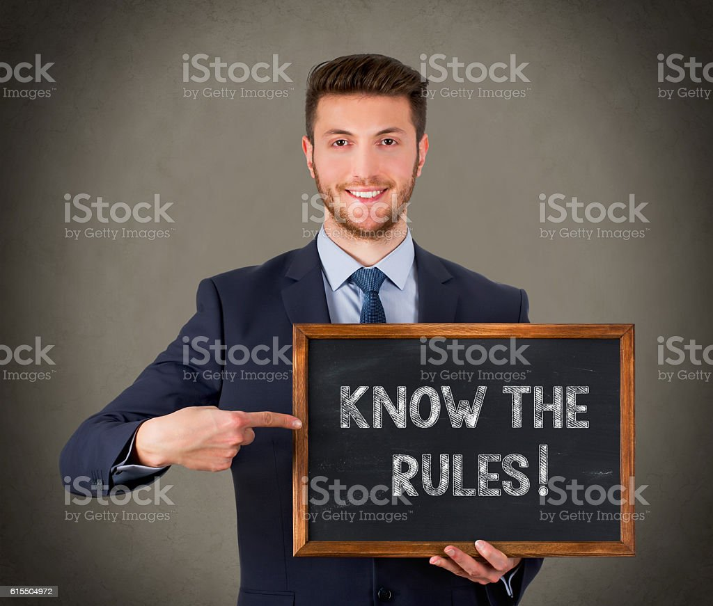 Writing Know The Rules on Blackboard stock photo