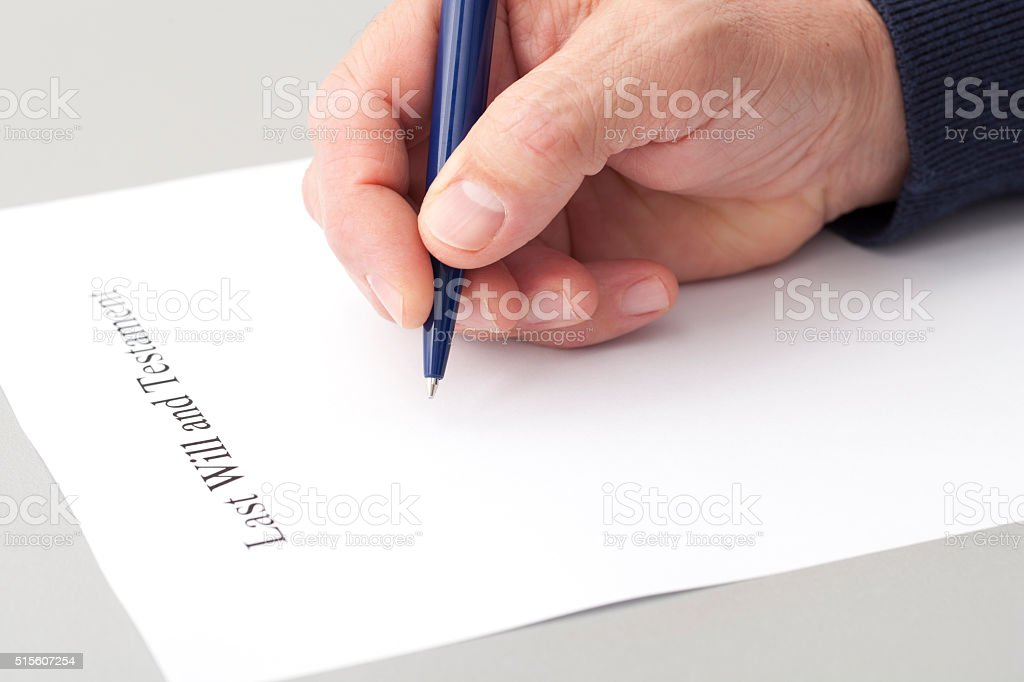Writing Last Will and Testament stock photo
