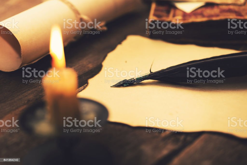 writing letter in candlelight. vintage items on the table stock photo