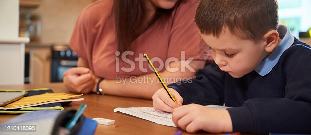 858130938 istock photo Writing new words for homework 1210418093