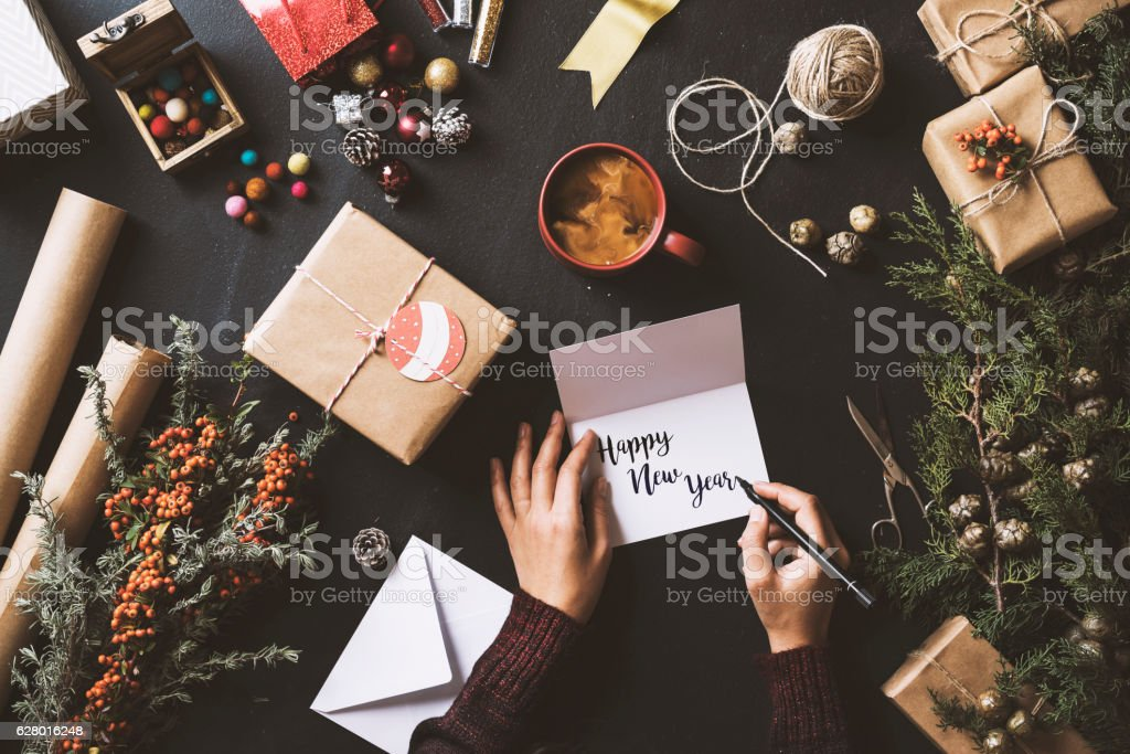 Writing New Year cards, table top flat lay stock photo