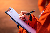 istock Writing note on paper - Audit and inspection in oil field operation. 1205235181