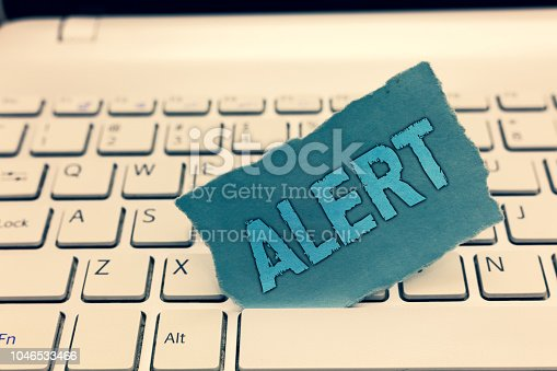 istock Writing note showing Alert. Business photo showcasing An announcement Signal warning of danger The state of being vigilant 1046533466