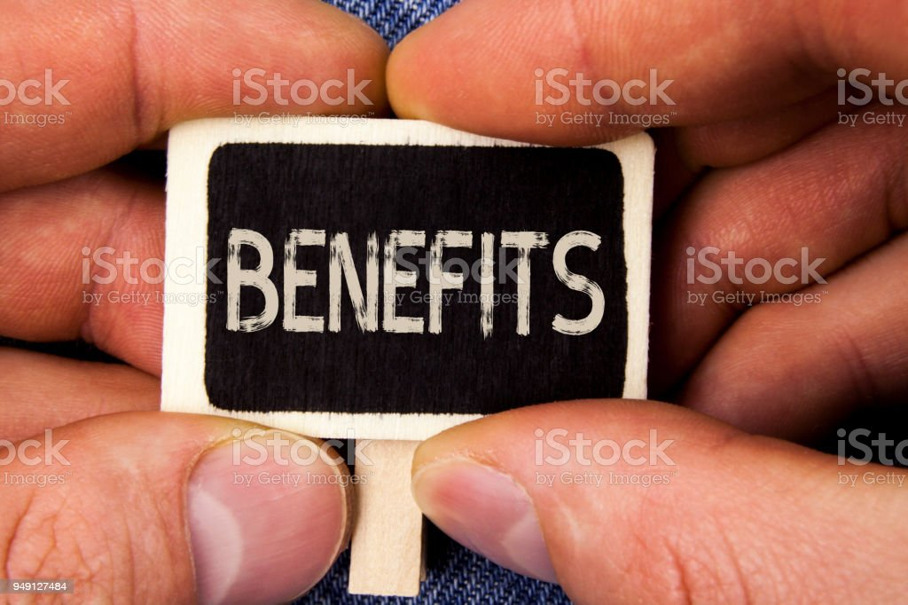 Writing note showing  Benefits. Business photo showcasing hike in allowance for senior employees of the company written on Wood Piece holding by man on the Blue Jeans background. stock photo