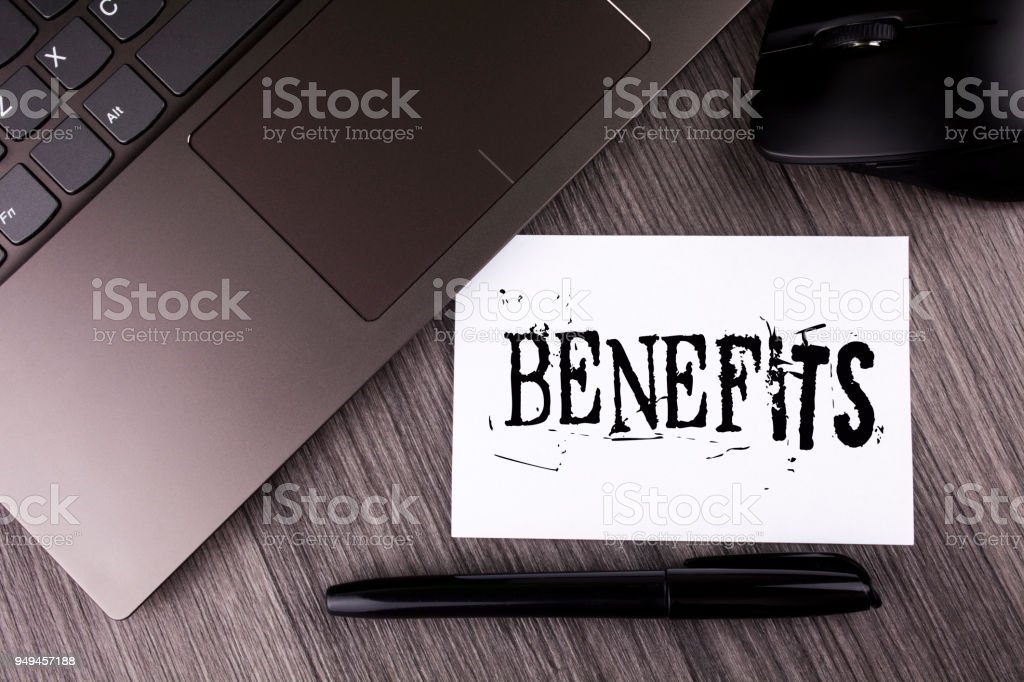 Writing note showing  Benefits. Business photo showcasing hike in allowance for senior employees of the company written on Sticky Note Paper on the wooden background Laptop Mouse Pen stock photo