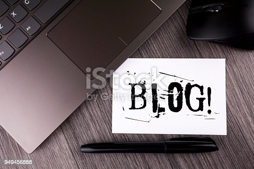 istock Writing note showing  Blog Motivational Call. Business photo showcasing Preperation of Attractive content for blogging websites written on Sticky Note Paper on the wooden background Laptop Mouse Pen 949456888