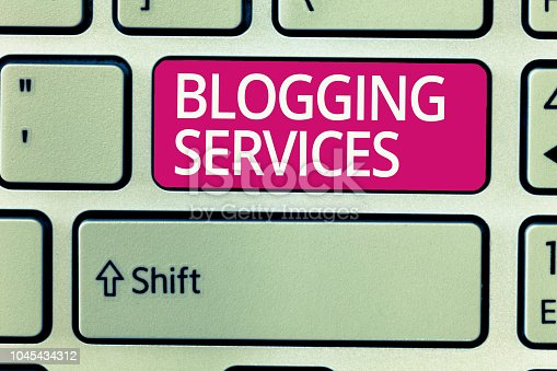 istock Writing note showing Blogging Services. Business photo showcasing Social networking facility Informative Journalism 1045434312
