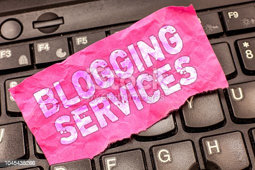 istock Writing note showing Blogging Services. Business photo showcasing Social networking facility Informative Journalism 1045435266