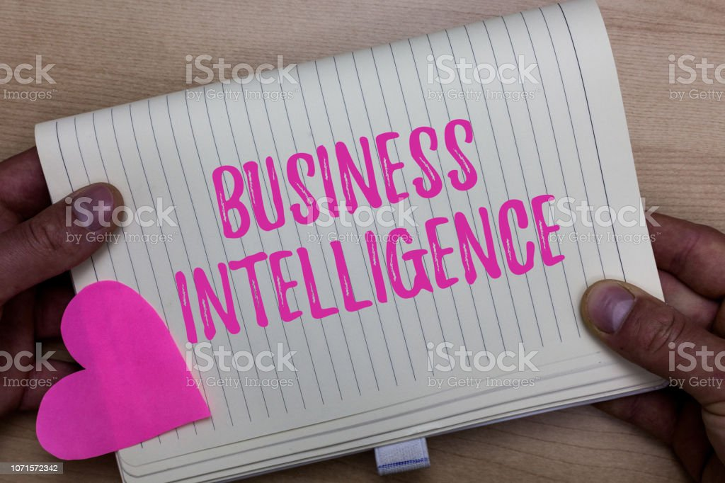 Writing note showing Business Intelligence. Business photo showcasing Best Practice of Information to Optimize Perforanalysisce Man holding notebook paper heart Romantic ideas Wooden background. stock photo