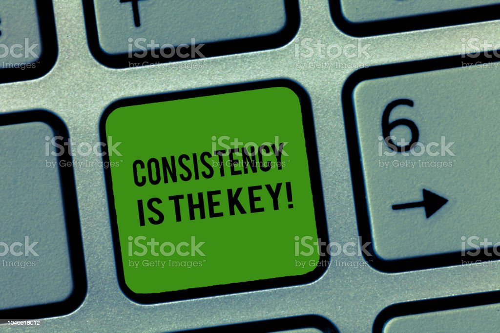 Writing note showing Consistency Is The Key. Business photo showcasing full Dedication to a Task a habit forming process stock photo