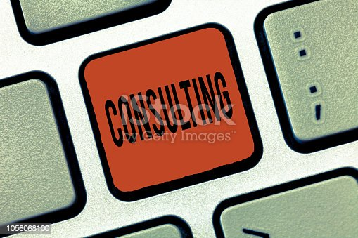 istock Writing note showing Consulting. Business photo showcasing Asking for expert advice opinion on particular subject Discussion 1056068100