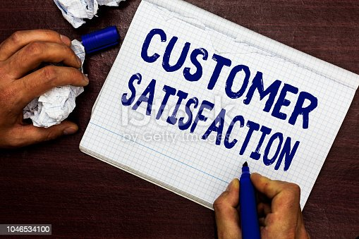 Writing note showing Customer Satisfaction. Business photo showcasing Exceed Consumer Expectation Satisfied over services Man holding marker notebook page crumpled paper several tries mistakes