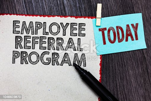 istock Writing note showing Employee Referral Program. Business photo showcasing employees recommend qualified friends relatives White page red borders marker clothespin reminder wooden background. 1046623870