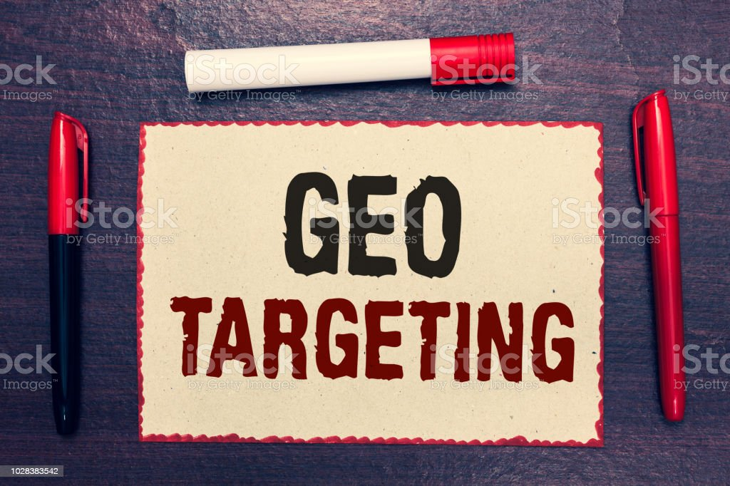Writing note showing Geo Targeting. Business photo showcasing Digital Ads Views IP Address Adwords Campaigns Location Open notebook page markers communicating ideas with wooden background – zdjęcie