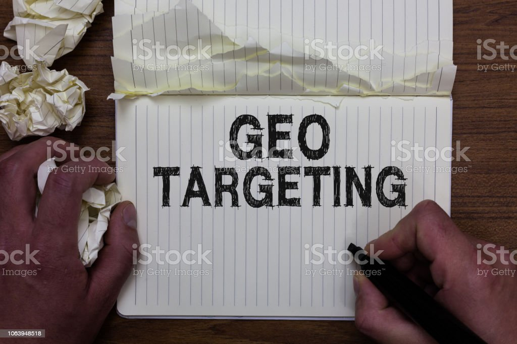 Writing note showing Geo Targeting. Business photo showcasing Digital Ads Views IP Address Adwords Campaigns Location Man holding marker notebook crumpled papers ripped pages mistakes made. – zdjęcie