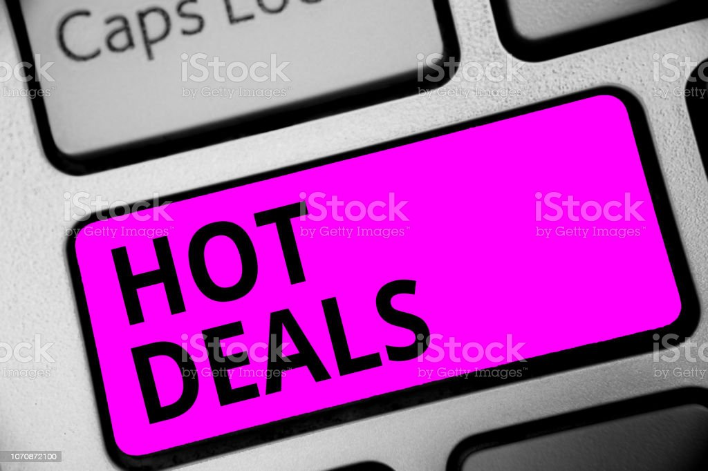 Writing note showing Hot Deals. Business photo showcasing An agreement through which one of the paties is offered and accept Keyboard purple key Intention computer computing reflection document. stock photo