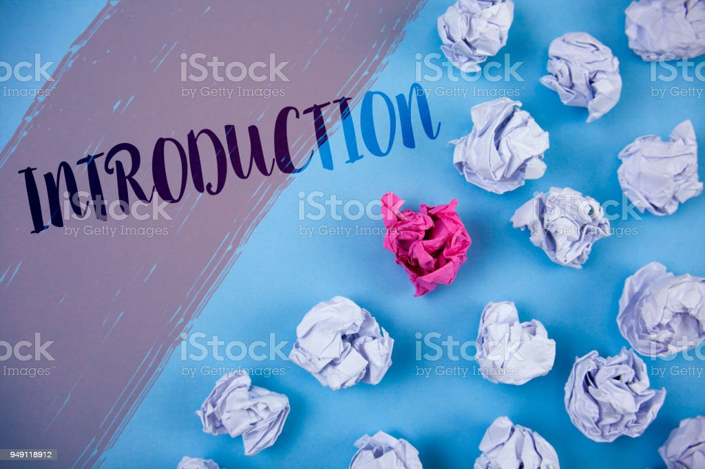 Writing note showing  Introduction. Business photo showcasing First part of a document Formal presentation to an audience written on Painted background Crumpled Paper Balls next to it. stock photo