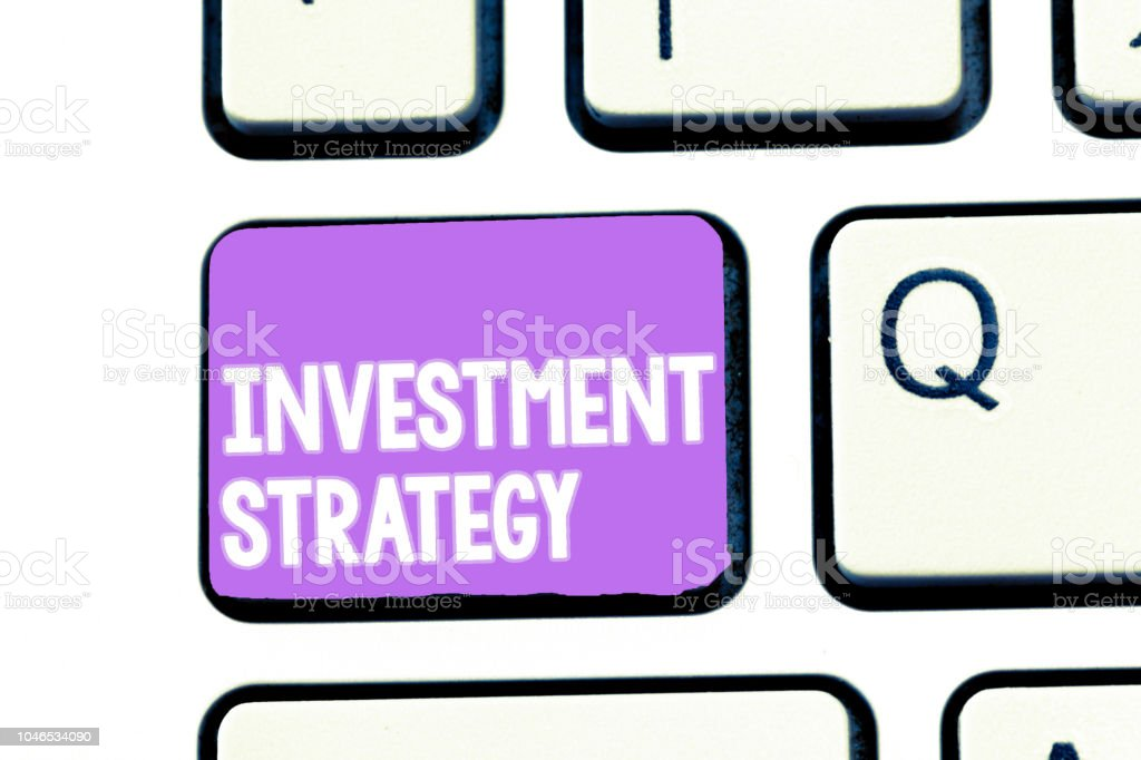 Writing note showing Investment Strategy. Business photo showcasing Set of Rules Procedures Behavior a Guide to an Investor stock photo