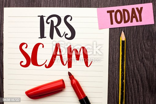 istock Writing note showing  Irs Scam. Business photo showcasing Warning Scam Fraud Tax Pishing Spam Money Revenue Alert Scheme written on Notebook Paper on the Wooden background Today Marker Pencil. 943818702