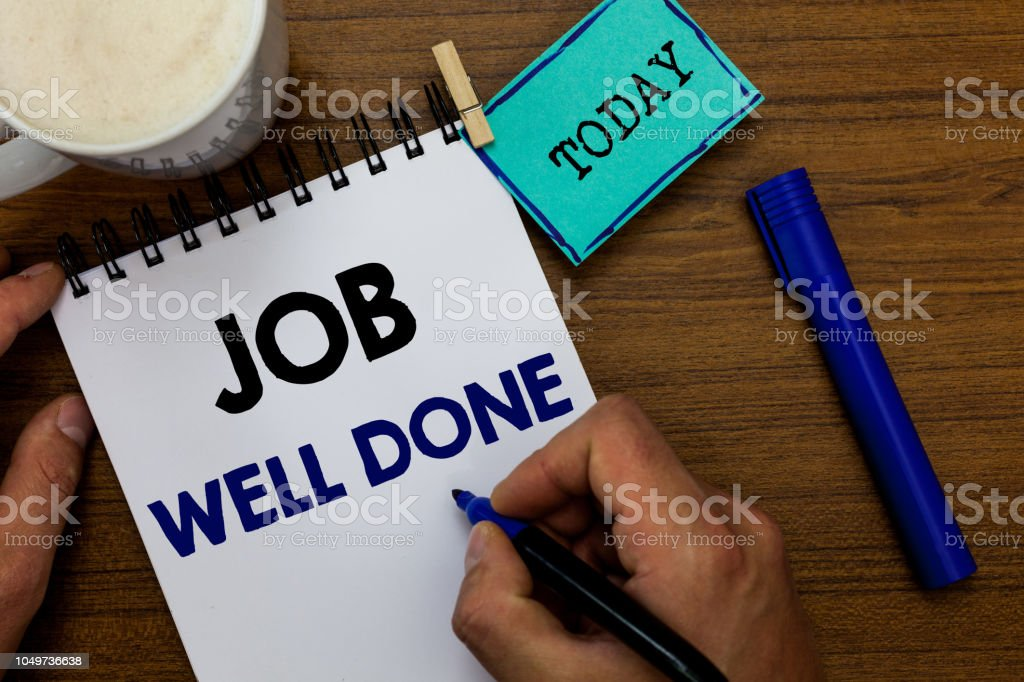 Writing note showing Job Well Done. Business photo showcasing Well Performed You did it Cheers Approval Par Accomplished Man holding marker notebook clothespin reminder wooden table coffee. stock photo