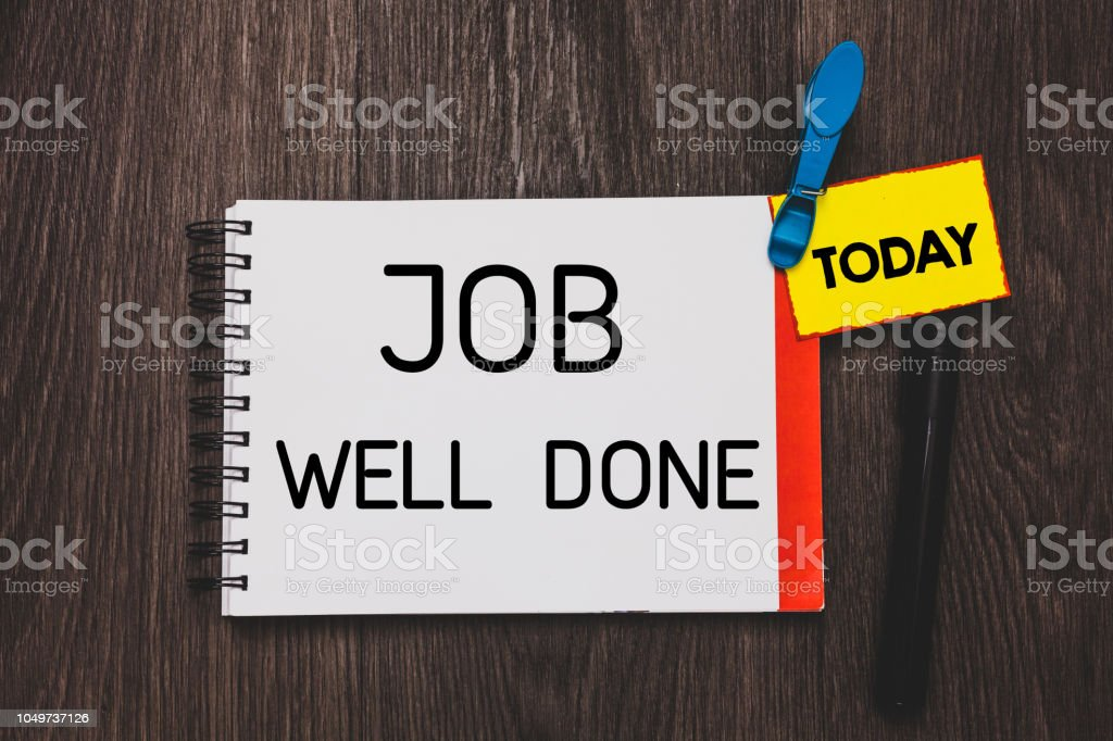 Writing note showing Job Well Done. Business photo showcasing Well Performed You did it Cheers Approval Par Accomplished Open notebook white page clothespin holding reminder wooden background. stock photo