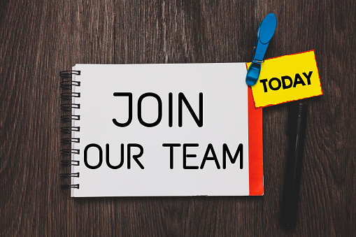 istock Writing note showing Join Our Team. Business photo showcasing Allied Associate Work with us New Employee Hired Enlist Open notebook white page clothespin holding reminder wooden background. 1049737112