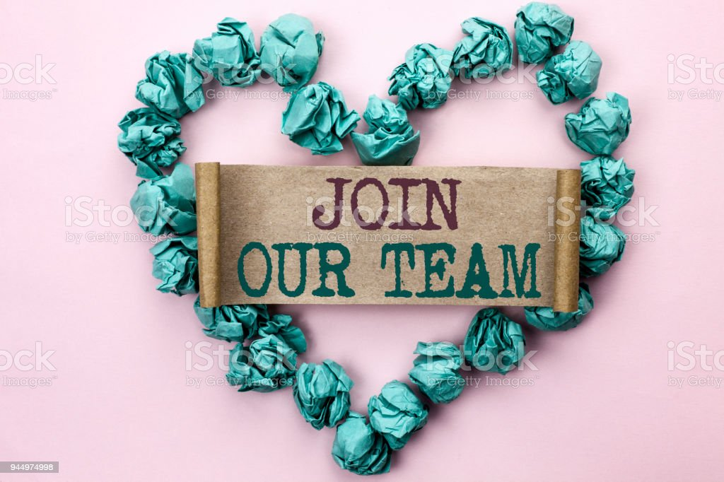 Writing note showing  Join Our Team. Business photo showcasing Be a Part of our Teamwork Workforce Wanted Recruitment written on Cardboard Piece on Heart on the light pink plain background. stock photo