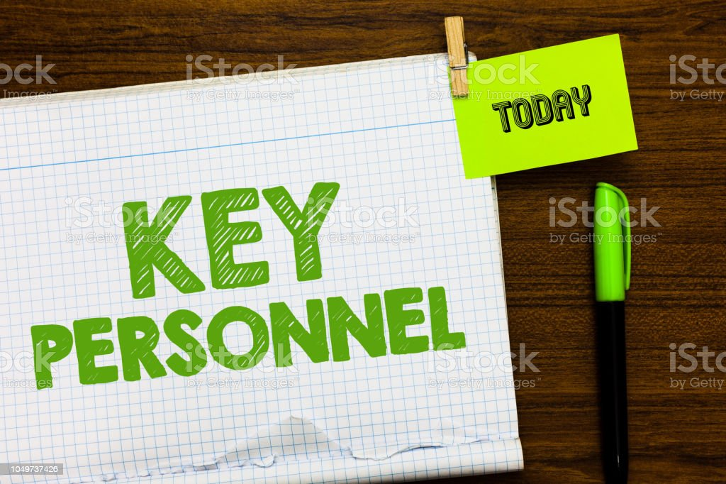 Writing note showing Key Personnel. Business photo showcasing Program Directors Principal Investigator Project Executives Open notebook page markers holding paper heart wooden background. stock photo