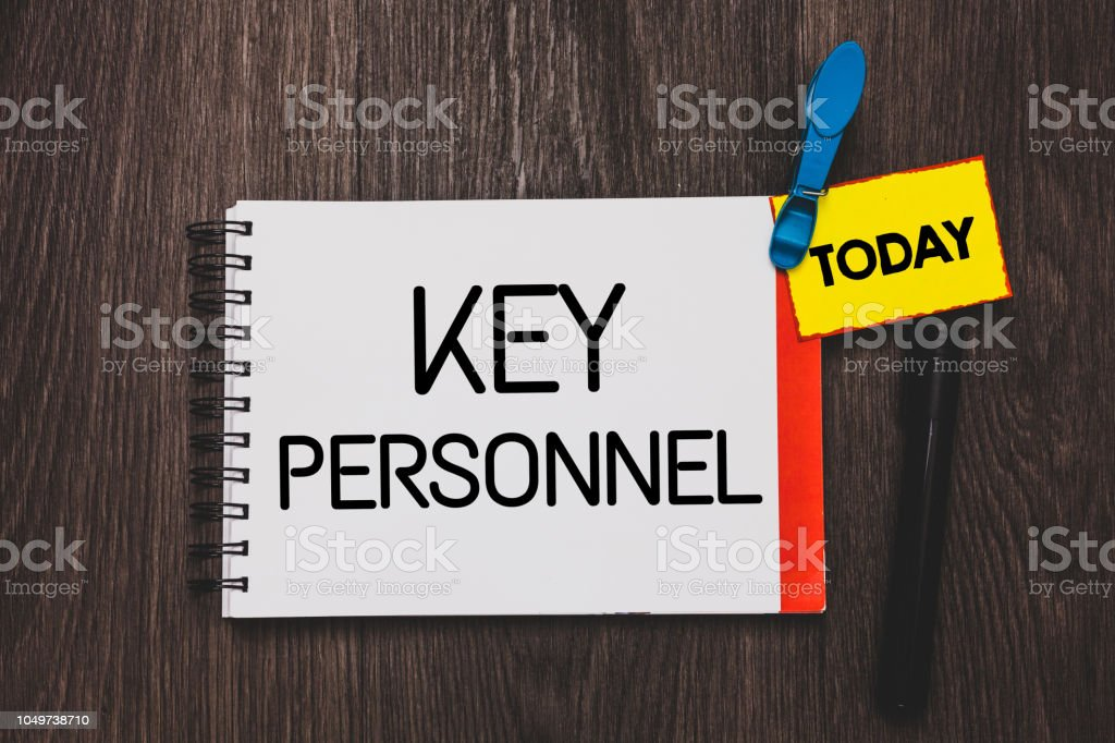 Writing note showing Key Personnel. Business photo showcasing Program Directors Principal Investigator Project Executives Open notebook white page clothespin holding reminder wooden background. stock photo