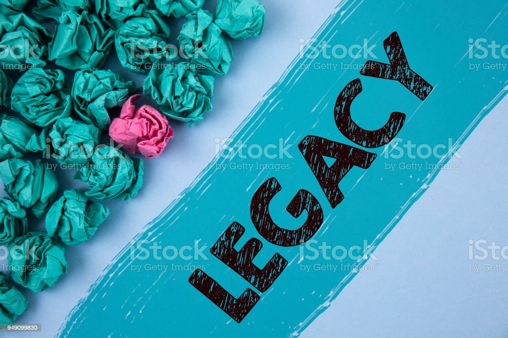 Writing note showing  Legacy. Business photo showcasing Transmitted Received from an ancestor Money Properties given by will written on Painted background Crumpled Paper Balls next to it. stock photo