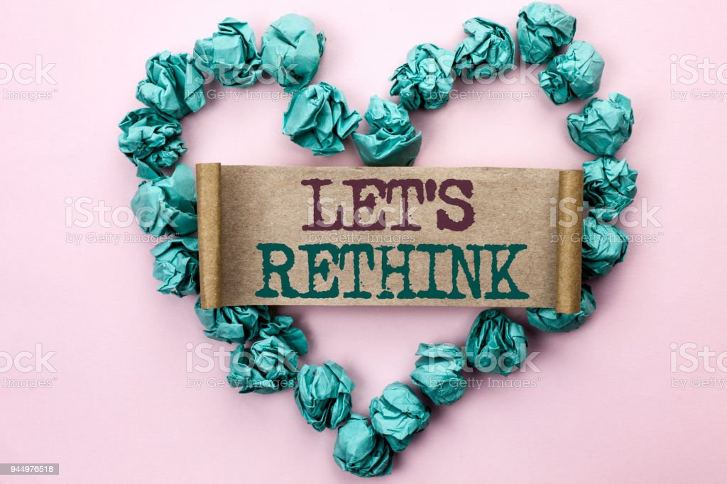 Writing note showing  Let Us Rethink. Business photo showcasing Give people time to think things again Remodel Redesign written on Cardboard Piece on Heart on the light pink plain background. stock photo