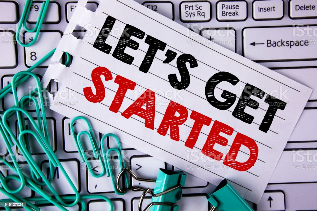 Writing note showing  Lets Get Started. Business photo showcasing beginning time motivational quote Inspiration encourage written on Tear Notepad paper placed on Keyboard Clips and Paper Pins. stock photo