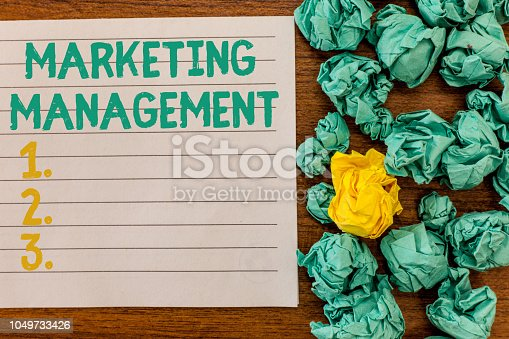 istock Writing note showing Marketing Management. Business photo showcasing Develop Advertise Promote a new Product or Service 1049733426
