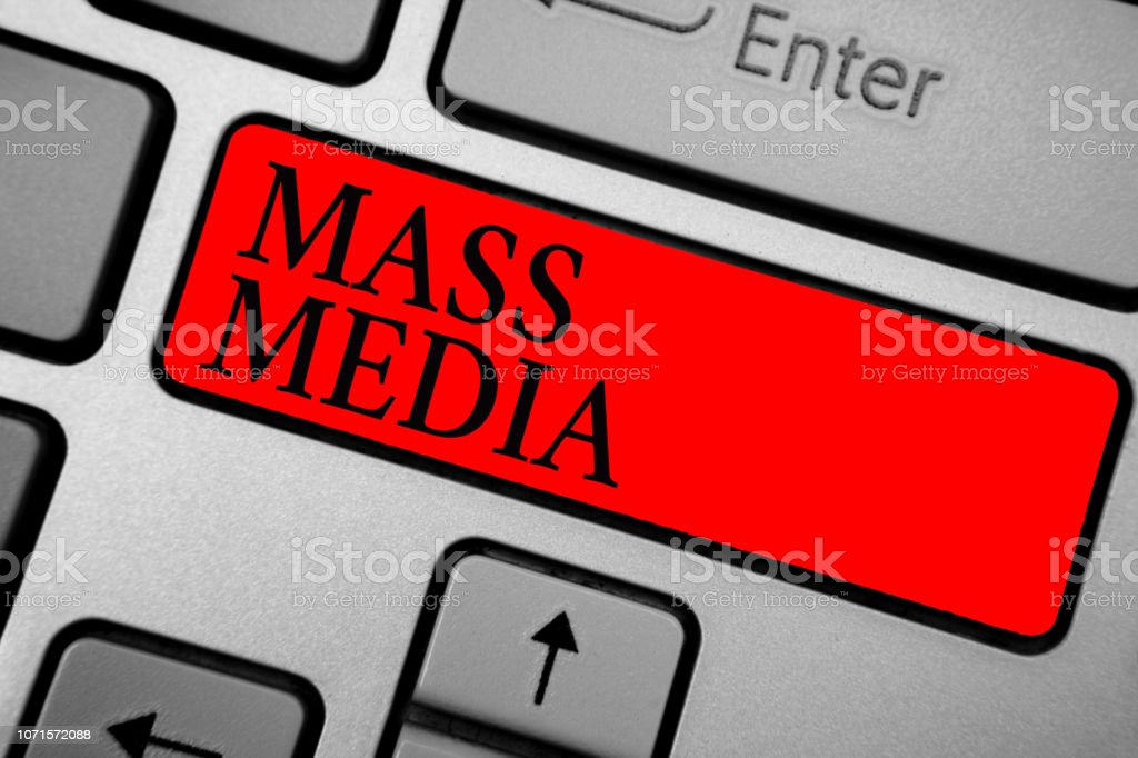 Writing note showing Mass Media. Business photo showcasing Group people making news to the public of what is happening Keyboard red key Intention computer computing reflection document. stock photo