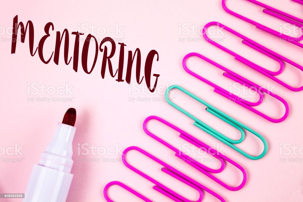 Writing note showing  Mentoring. Business photo showcasing To give advice or support to a younger less experienced person written on Plain Pink background Marker and Paper Pins next to it. stock photo