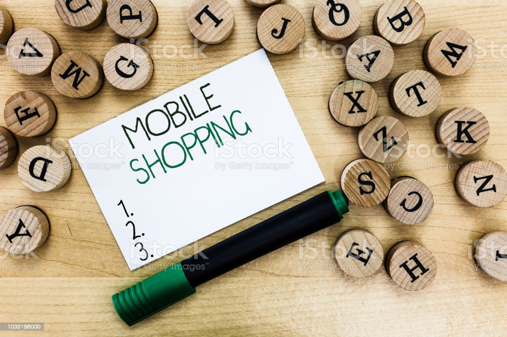 Writing note showing Mobile Shopping. Business photo showcasing Buying and selling of goods and services through mobile stock photo